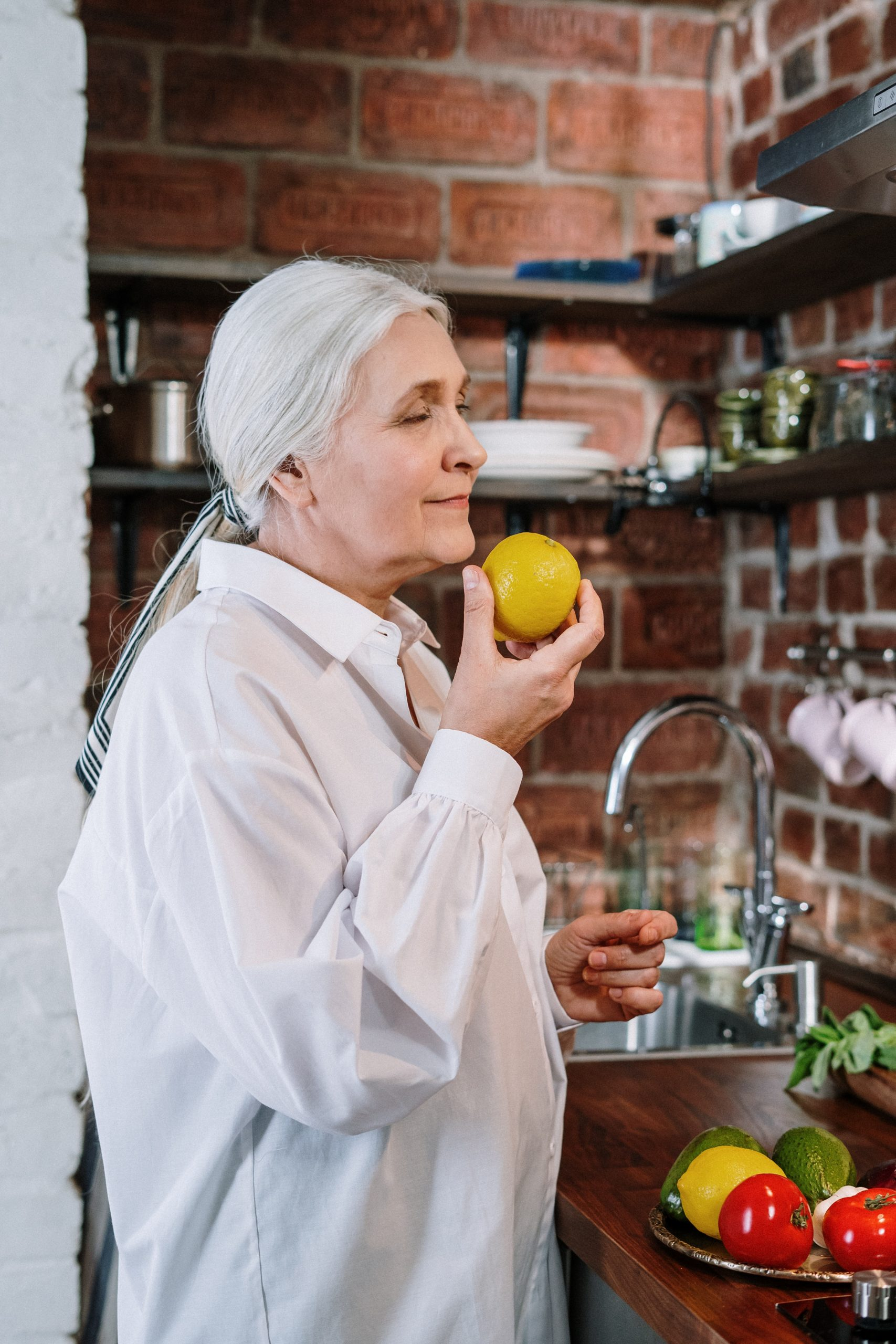 woman sniffing a lemon
